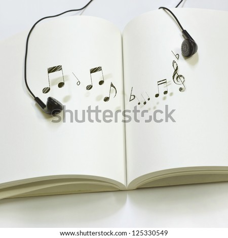 Book with melody in relaxation - stock photo