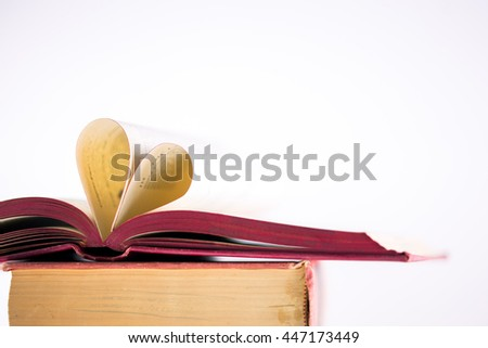 Book with opened pages and shape of heart isolate on white background
