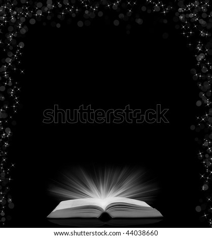 book with rays of light background
