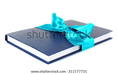 Book wrapped with color ribbon isolated on white - stock photo