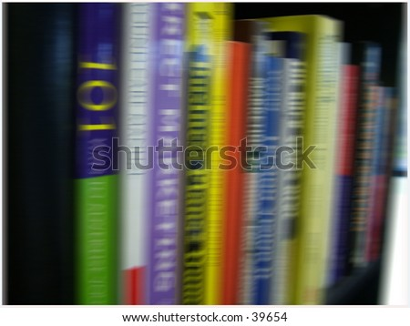 bookcase full of business reference material - stock photo
