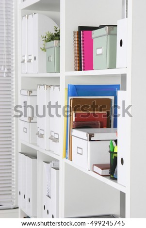 bookcase with folders in the office businessman.