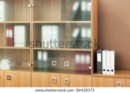 bookcase with glass doors in a modern office - stock photo