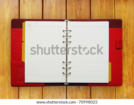 Booklet on the wooden table - stock photo