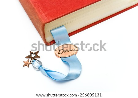 Bookmark in a book isolated on white - stock photo