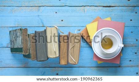 books and a cup of coffee, learning / education concept, free copy space - stock photo