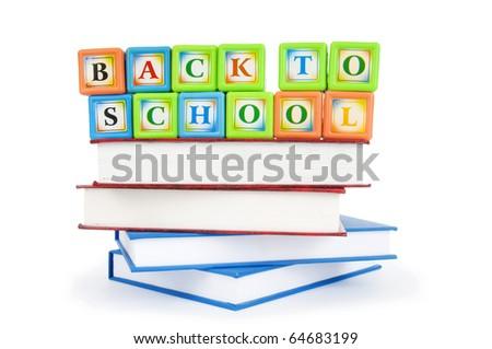 Books and alphabet blocks isolated on white - stock photo