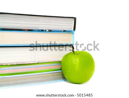 books and apple. isolated on white