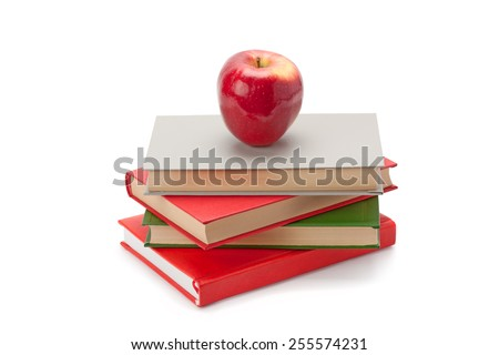 books and apple isolated on white background - stock photo