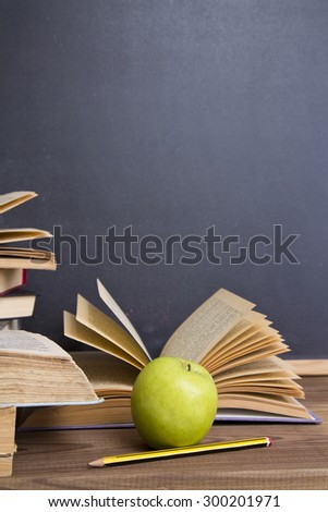 books and apple slate background - stock photo