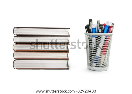 Books and ballpoints isolated on white background. - stock photo