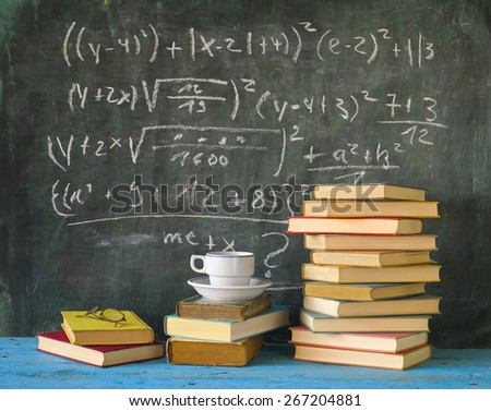Books and blackboard, learning,education concept - stock photo