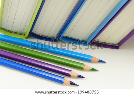 Books and crayons in cool colors.