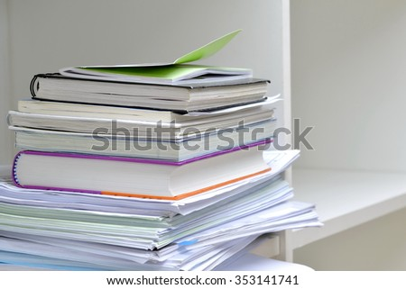 Books and documents on bookshelf - stock photo