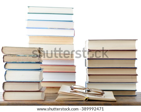 Books and eyeglasses with isolated background - stock photo