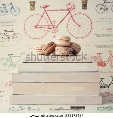 Books and macaroons  - stock photo