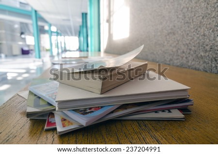 books and magazines on table - stock photo