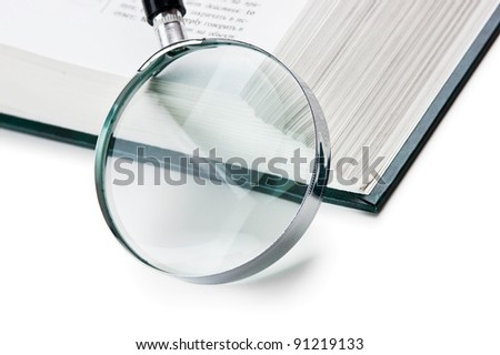 books and magnifying glass isolated on white background