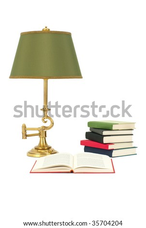 Books and Reading Lamp Isolated on White - stock photo