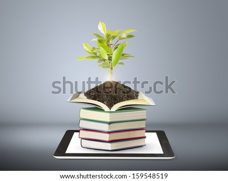 Books and tablet computer digital library  - stock photo