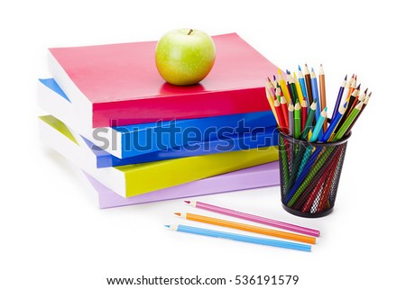 Books and various pens and pencils displayed in this education or back to school themed image isolated on white background