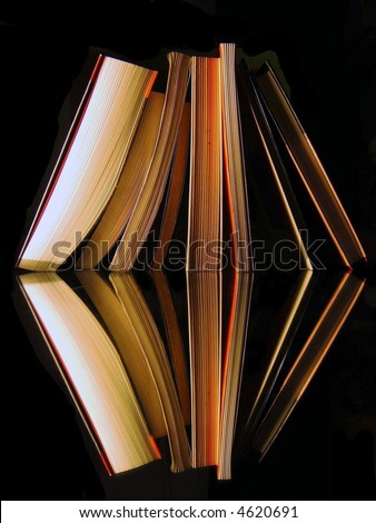 books are reflected in a mirror