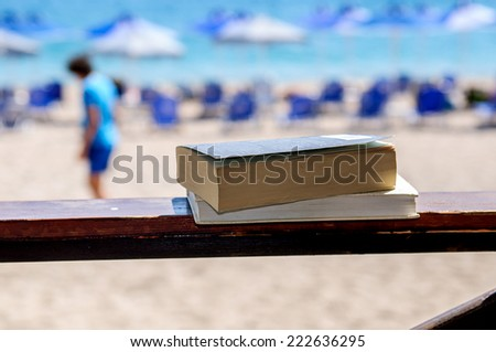 Books at beach reading during summer time - stock photo