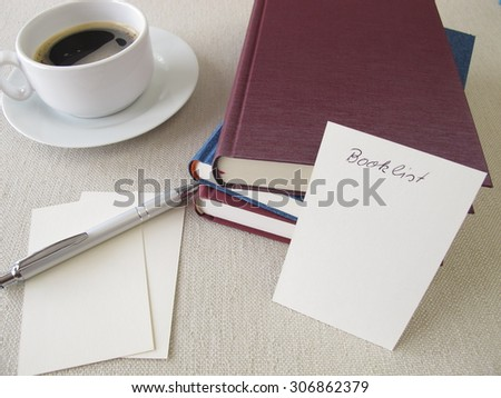 Books, blank booklist and cup of coffee - stock photo