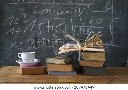 books, cup of coffee, black board, education,learning,science concept - stock photo