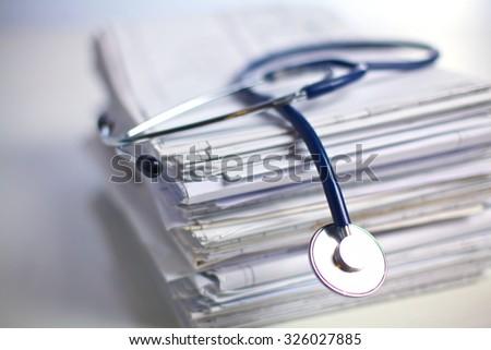 books folder file and stethoscope isolated on white background - stock photo