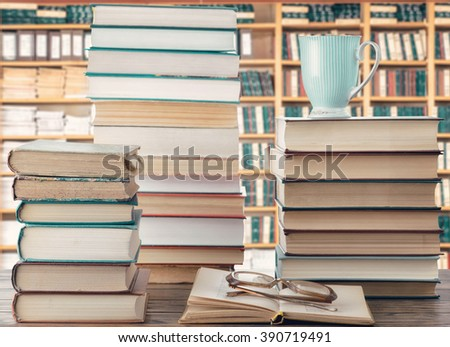 Books, glasses and a cup - stock photo
