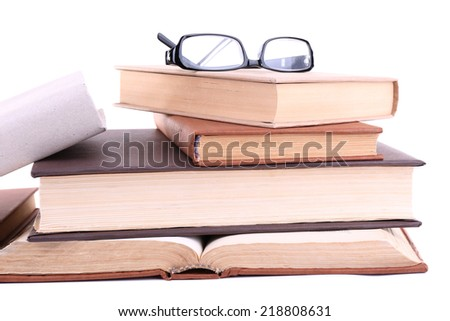 Books in a mess and glasses isolated on white - stock photo