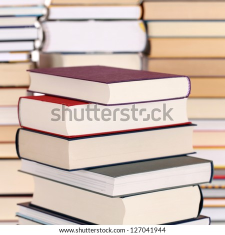 Books in a stack, with more books forming a background