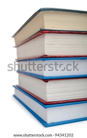 Books in high stack isolated on white - stock photo