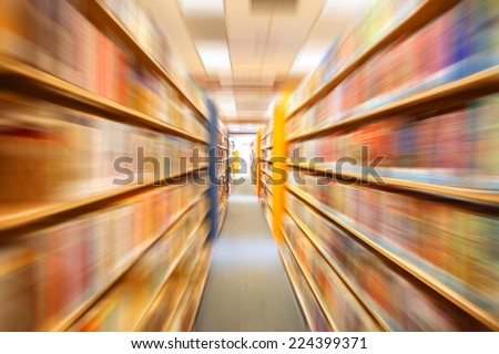 Books in public library, motion blur - stock photo