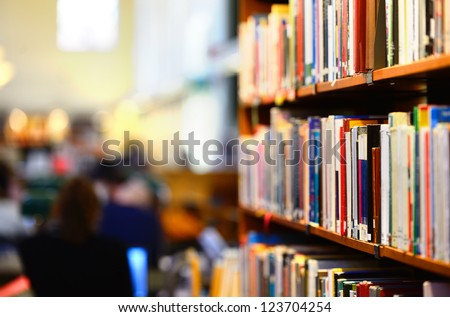 Books in public library, shallow DOF.