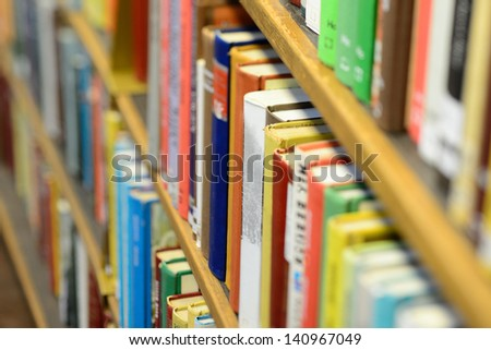 Books in shelf in library - stock photo