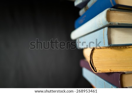 books in the bookshelf with black background - stock photo