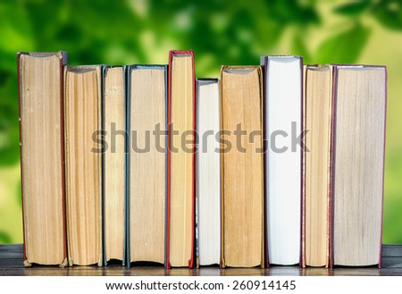 Books in the garden - stock photo