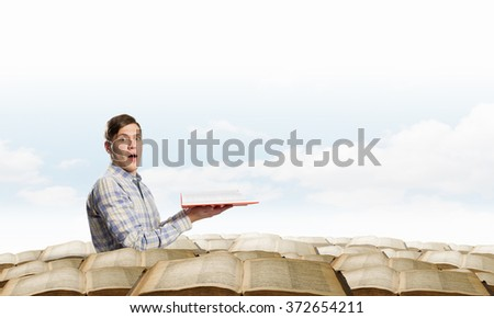 Books let you rise above the rest - stock photo