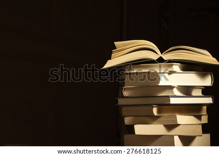 books lie on each other. with copy-space - stock photo