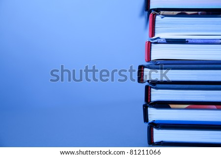 books lie on each other. with copy-space, small depth to sharpness - stock photo