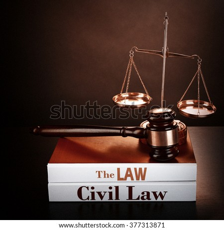 Books of Law on table on brown background. Retro stylization