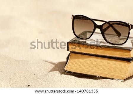 Books on a beach - stock photo