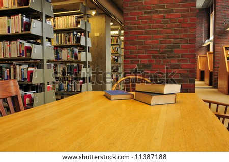 Books on a library table - stock photo