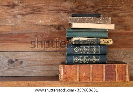 books on a wooden shelf - stock photo