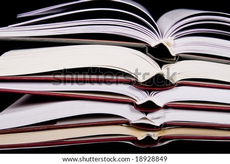books on black background - stock photo