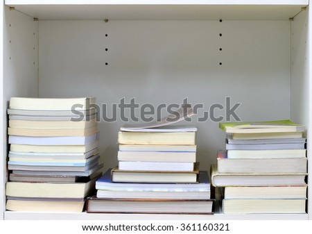 Books on bookshelf - stock photo
