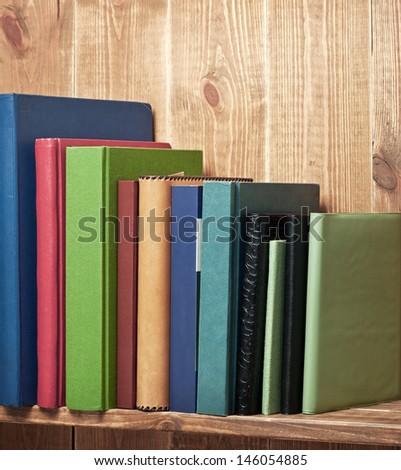 Books on the brown bookshelf - stock photo