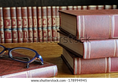 books on the table and classes and the bottom shelf - stock photo